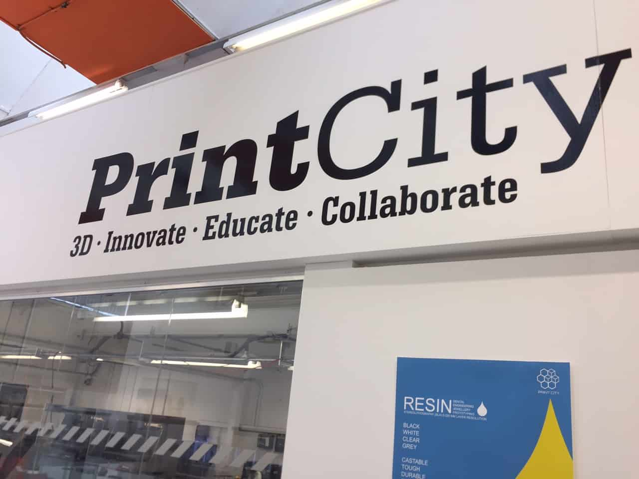 print city text on a wall