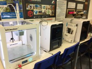 image of row of 3D printers